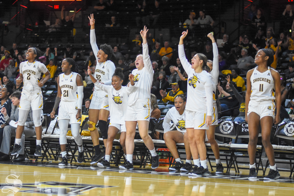 Wichita State players celebrate from the bench after scoring a three against the Oklahoma Sooners on Saturday, Nov. 30 inside Charles Koch Arena.