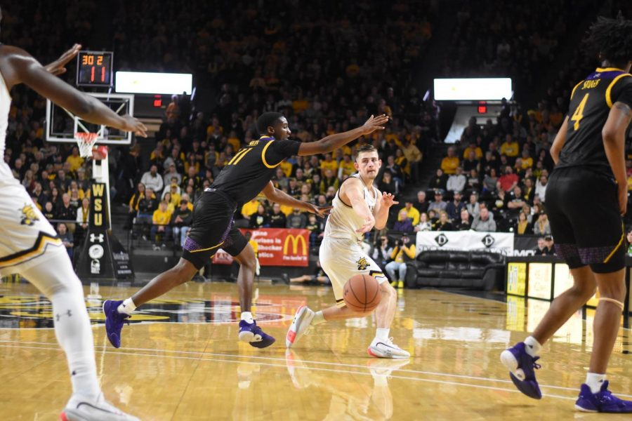 Wichita State sophomore Erik Stevenson makes a bounce pass to Morris Udeze during the first half of the game against the East Carolina Pirates on Wednesday.