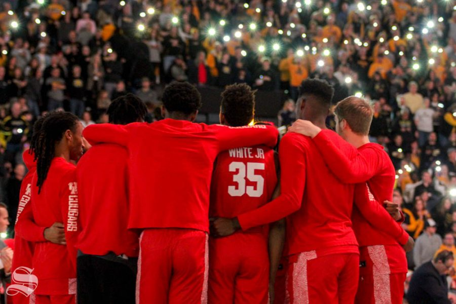 The+Houston+Cougars+gather+in+a+huddle+prior+to+the+game+against+Wichita+State+on+Saturday+inside+Charles+Koch+Arena.