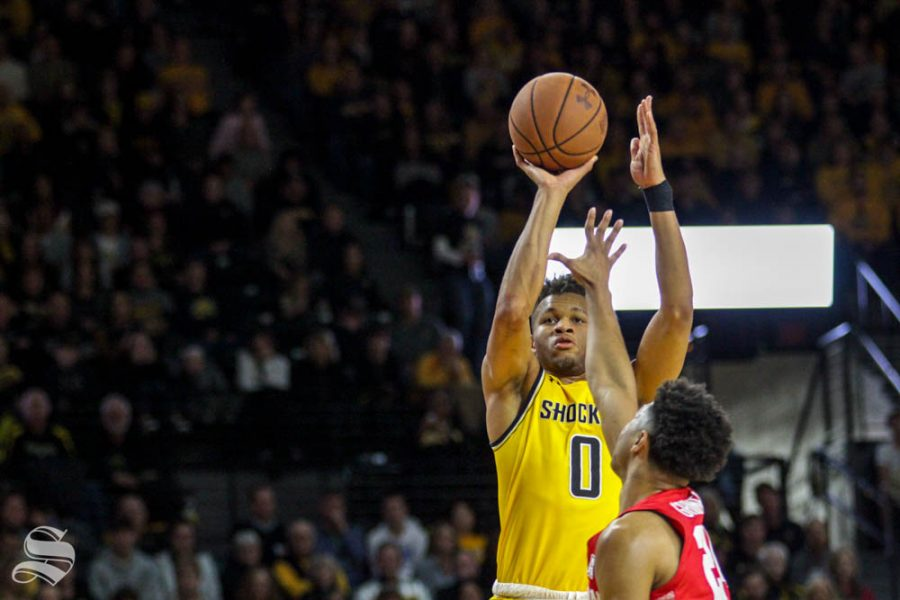 Wichita State sophomore Dexter Dennis shoots a three-pointer during the game against Houston on Saturday inside Charles Koch Arena.