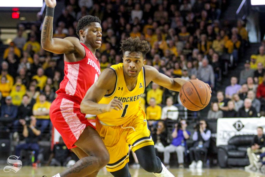 Wichita+State+freshman+Tyson+Etienne+dribbles+past+a+defender+during+the+first+half+of+the+game+against+Houston+on+Saturday+inside+Charles+Koch+Arena.