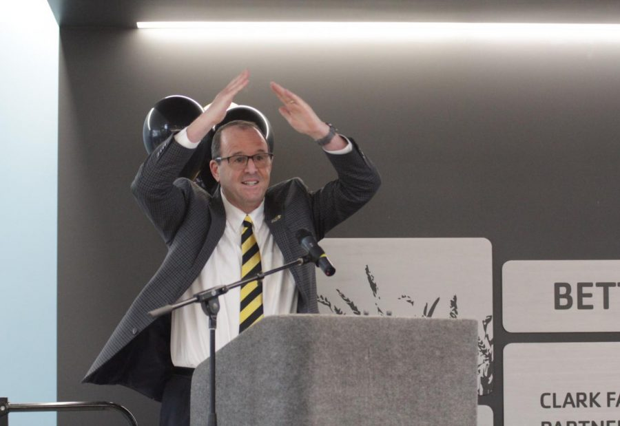Wichita State President Jay Golden does the YMCA dance at the grand opening of the Steve Clark YMCA and Student Wellness Center on Tuesday, Jan. 21.