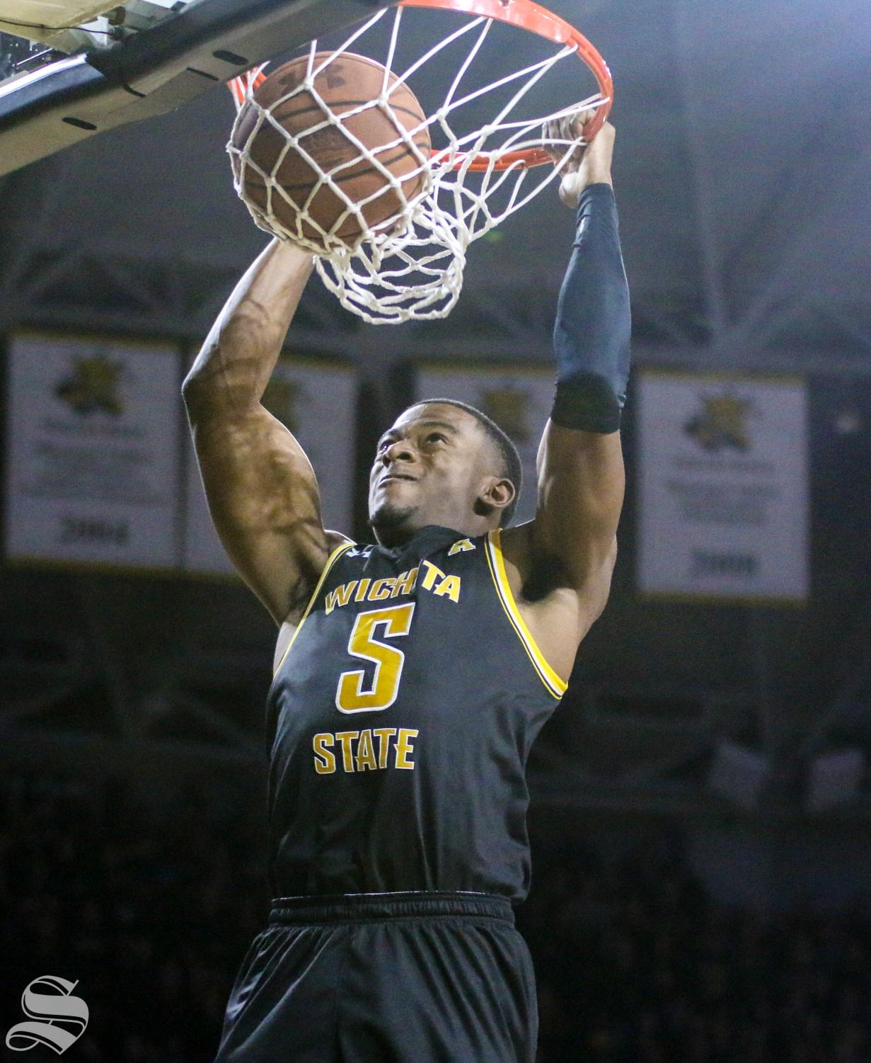 Wichita State's Trey Wade dunks on Memphis during the game at Koch Arena on Thursday, Jan. 9, 2019.