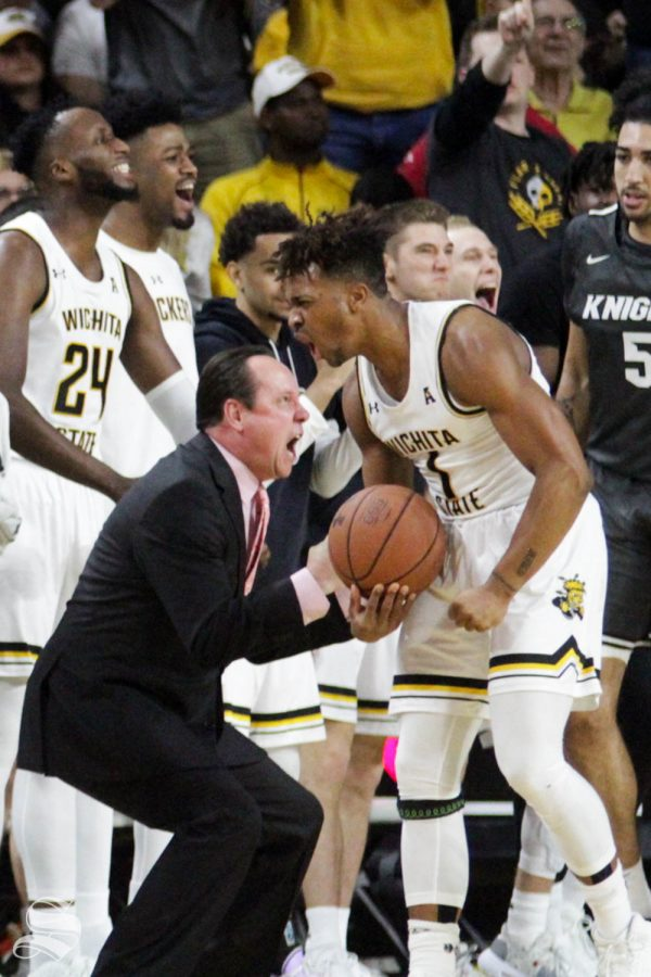 Wichita State Head Coach Gregg Marshall and freshman guard Tyson Etienne celebrate after Etienne forces a turnover during the first half of the game against Central Florida on Jan. 25 inside Charles Koch Arena.