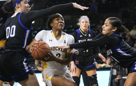 Wichita State's Mariah McCully drives toward the basket during the game against Tulsa at Charles Koch Arena on Wednesday, Jan. 15, 2020.