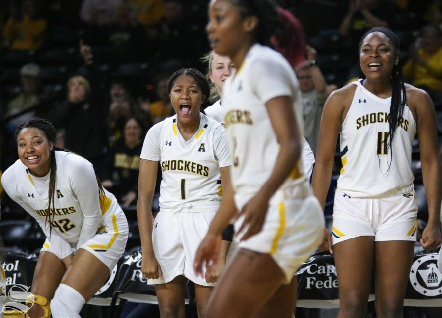 Wichita State bench celebrates after Mariah McCully is fouled during the game against Tulsa at Charles Koch Arena on Wednesday, Jan. 15, 2019.