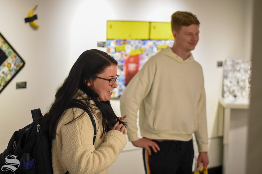 Sophia+Glasgow%2C+a+junior+studying+and+entrepreneurship+and+marketing%2C+looks+over+Julian+Kincaid%27s+art+gallery+in+the+Cadman+in+the+RSC+on+Thursday%2C+Jan.+23.