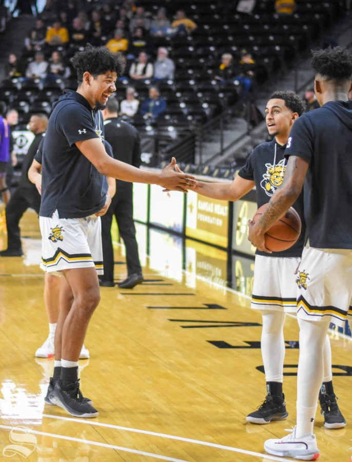 Wichita+State%27s+Isaiah+Poor-Bear+Chandler+and+Noah+Fernandes+engage+in+a+handshake+during+the+warmup+of+the+game+agianst+the+East+Carolina+Pirates+on+Wednesday.