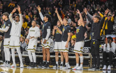 Wichita State's bench celebrates after a three-point shot was made against the East Carolina Pirates on Wednesday.
