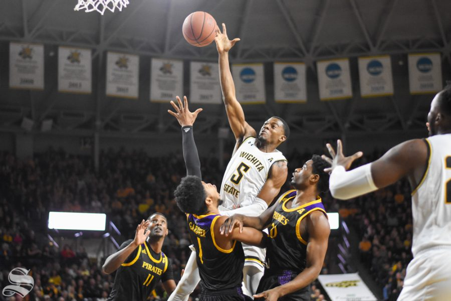 Wichita States Trey Wade jumps over East Carolina defenders for a basket during the game on Wednesday, Jan. 1.
