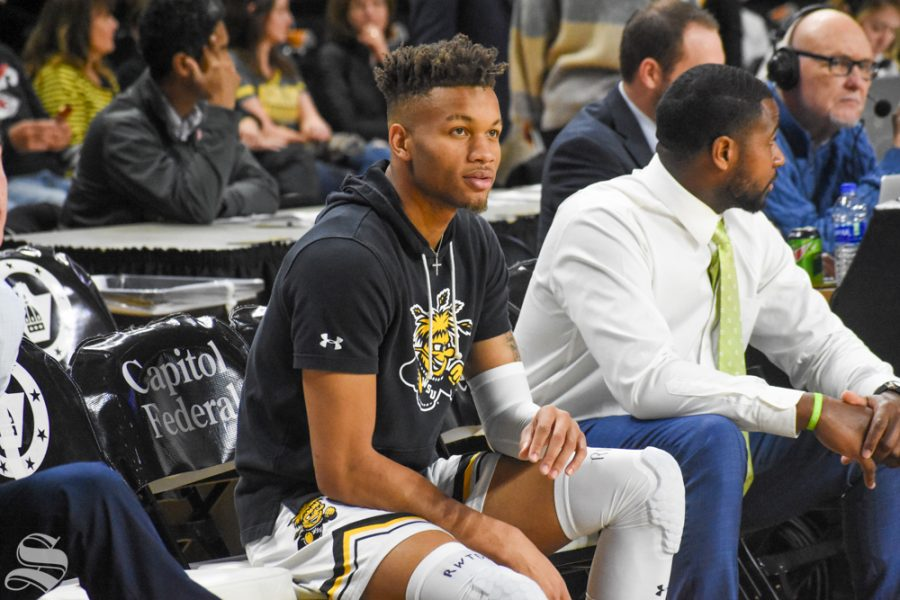 Wichita State's Dexter Dennis sits on the bench before the game against Ole Miss on Saturday, Jan. 4 inside Charles Koch Arena.