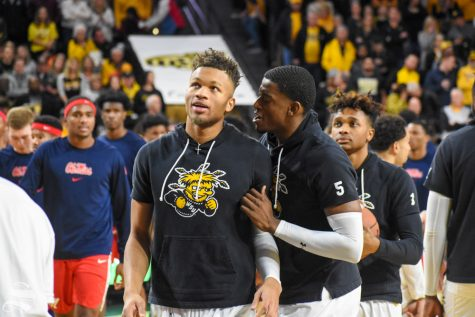 Wichita State junior Trey Wade talks to Dexter Dennis prior to tip-off of the game against the Ole Miss Rebels on Saturday.