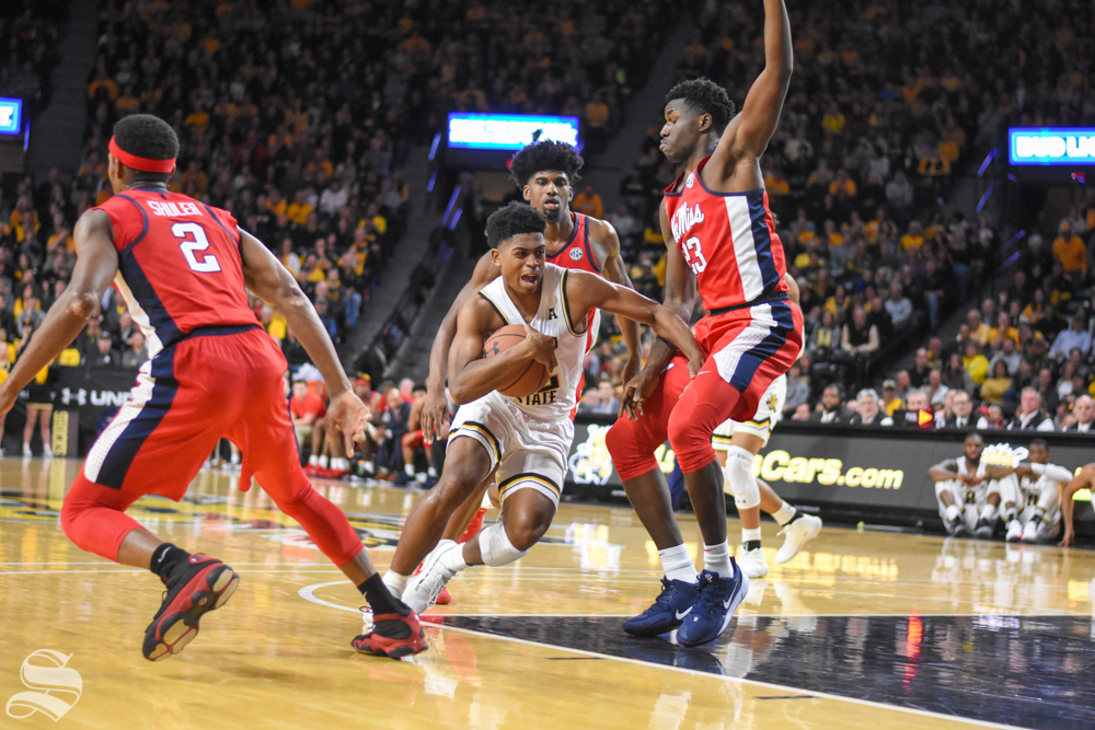 Wichita State's Grant Sherfield moves past Ole Miss defenders for a basket during the game on Saturday inside Charles Koch Arena.