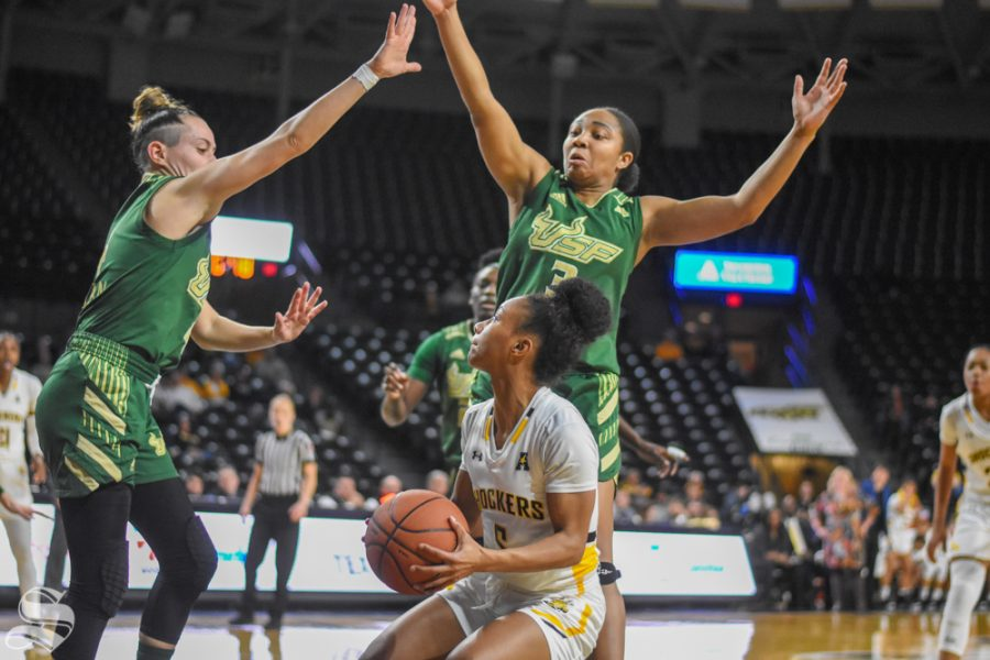 Senior+Ashley+Reid+goes+up+for+a+basket+while+USF+defenders+jump+to+block+the+shot+during+the+game+on+Wednesday.