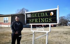 Neil Terry, mayor of Geuda Springs, Kansas, and Wichita State sophomore, stands next to the Geuda Springs (population 185) town sign.