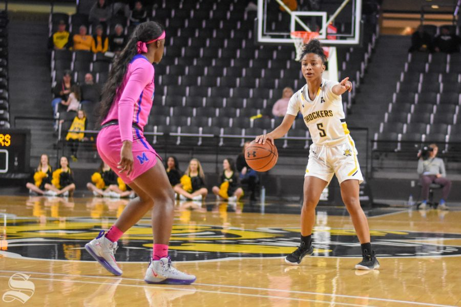 Wichita+State%27s+Ashley+Reid+looks+for+a+pass+above+the+three-point+line+during+the+game+against+the+Memphis+Tigers+on+Wednesday.