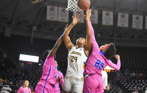 Wichita State sophomore Trajata Colbert goes up for a layup during the game against the Memphis Tigers on Wednesday.