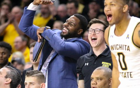 Wichita State graduate manager Ben Smith celebrates from the bench during the game against Cincinnati at Charles Koch Arena on Thursday, Feb. 6, 2020.