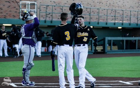 Wichita State freshman Cade Clemons celebrates after hitting a home run during the third inning of the game against Kansas State on Feb. 26 at Eck Stadium.