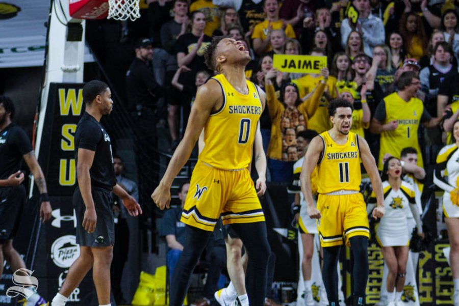 Wichita+State+sophomore+Dexter+Dennis+celebrates+after+Jaime+Echenique+dunked+the+ball+in+the+first+half+of+the+game+against+Tulane+on+Feb.+16+inside+Charles+Koch+Arena.