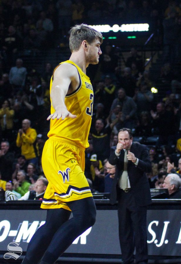 Wichita+State+junior+Asbj%C3%B8rn+Midtgaard+celebrates+after+Dexter+Dennis%27+alley-oop+dunk+in+the+first+half+of+the+game+against+Tulane+on+Feb.+16+inside+Charles+Koch+Arena.