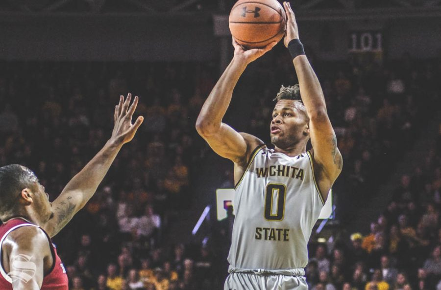 Wichita State sophomore Dexter Dennis shoots a three-pointer during the first half of the game against Temple on Feb. 27 inside Charles Koch Arena.