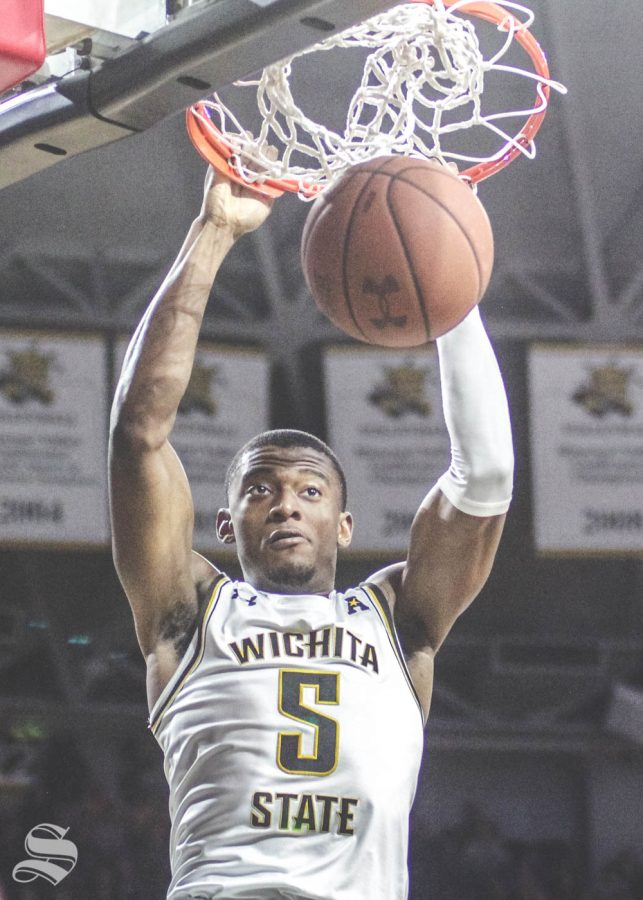 Wichita State junior Trey Wade dunks the ball during the first half of the game against Temple on Feb. 27 inside Charles Koch Arena.