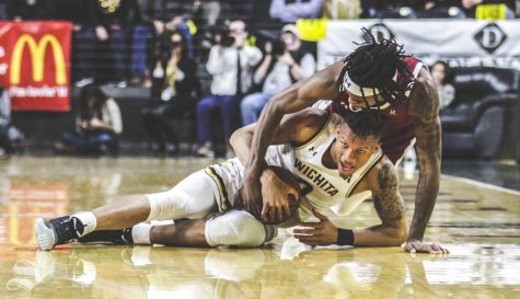 Wichita State sophomore Dexter Dennis fights for the ball with Temple