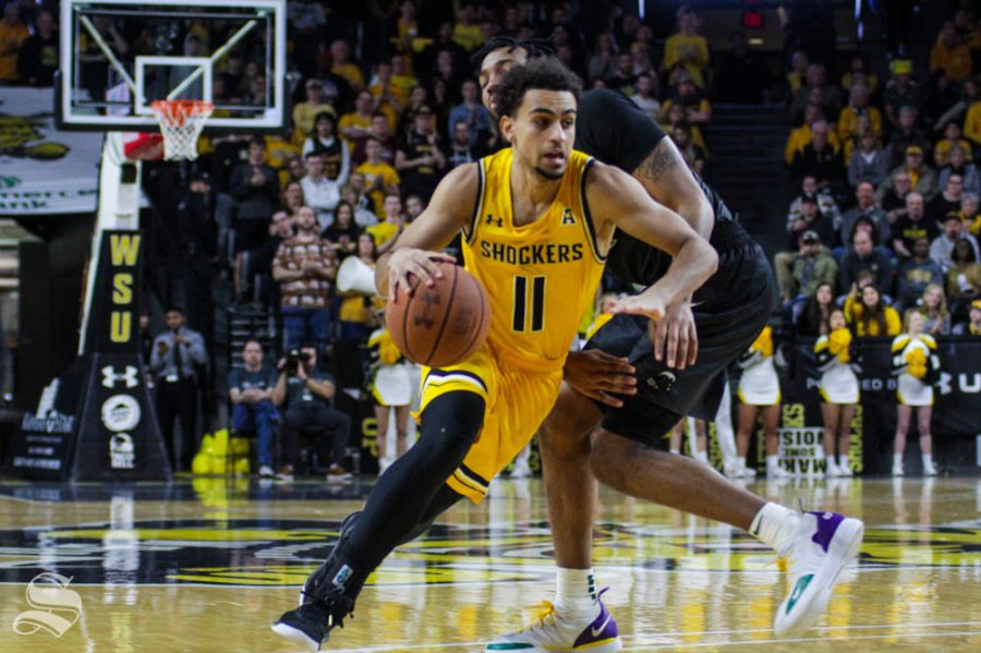 Wichita+State+freshman+Noah+Fernandes+drives+past+Tulane%27s+KJ+Lawson+during+the+second+half+of+the+game+against+Tulane+on+Feb.+16+inside+Charles+Koch+Arena.
