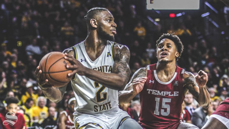 Wichita State sophomore Jamarius Burton looks to make a pass during the first half of the game against Temple on Feb. 27 inside Charles Koch Arena.