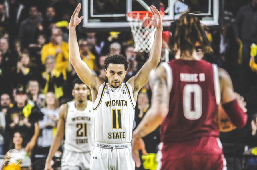 Wichita State freshman Noah Fernandes motions to excite the crowd during the first half of the game against Temple on Feb. 27 inside Charles Koch Arena.