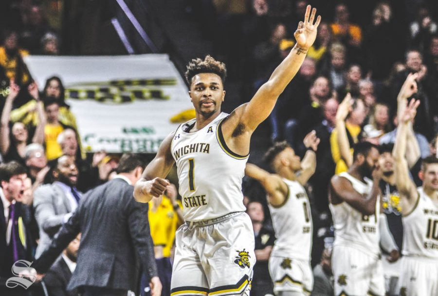 Wichita State freshman Tyson Etienne celebrates after junior Trey Wade hit a three-pointer in the first half of the game against Temple on Feb. 27 inside Charles Koch Arena.