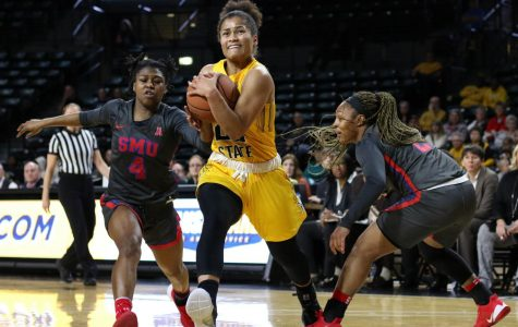 Wichita State's Seraphine Bastin breaks past Southern Methodist's defense during the second half of the game at Charles Koch Arena on Wednesday, Feb. 19, 2020.