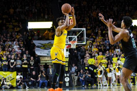 Wichita State freshman Tyson Etienne shoots a three-pointer during the second half of the game against Tulane on Feb. 16 inside Charles Koch Arena.