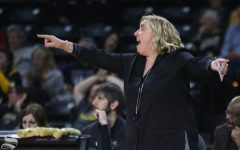 Adams ejected, Shockers lose to Cincinnati on senior day