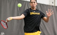 Wichita State senior Murkel Dellien volleys the ball back to UTA during the match held at Genesis Health Club on Friday, Feb. 21, 2020.