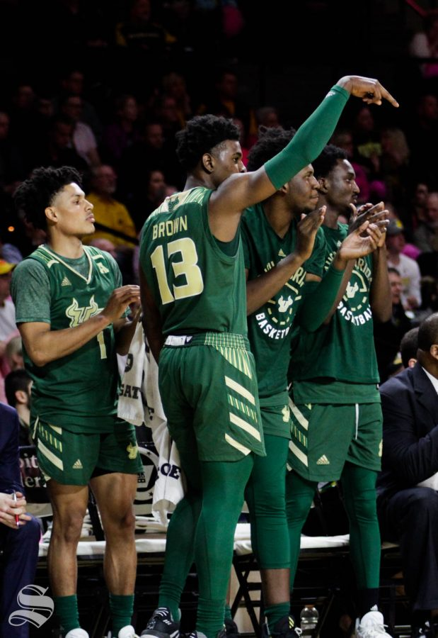 The South Florida bench celebrates after a made basket during the first half of the game against USF on Feb. 20 inside Charles Koch Arena.