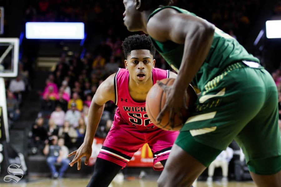 Wichita State freshman Grant Sherfield guards a USF ball-handler in the backcourt during the first half of the game against USF on Feb. 20 inside Charles Koch Arena.