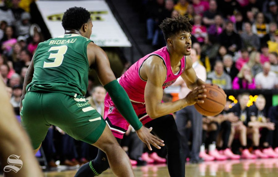 Wichita State freshman Tyson Etienne prepares to pass the ball during the first half of the game against USF on Feb. 20 inside Charles Koch Arena.