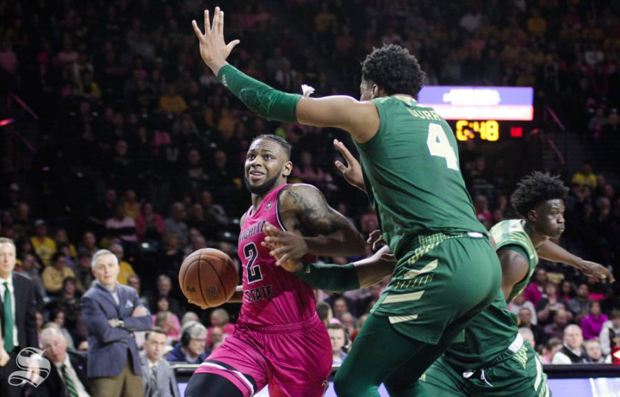 Wichita State sophomore Jamarius Burton prepares to go up for a layup during the first half of the game against USF on Feb. 20 inside Charles Koch Arena.