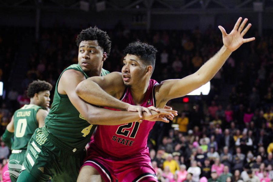 Wichita State senior Jaime Echenique calls for a pass during the second half of the game against USF on Feb. 20 inside Charles Koch Arena.