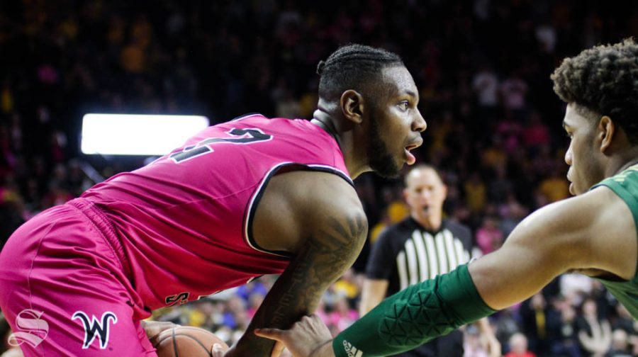 Wichita State sophomore Jamarius Burton looks to pass the ball during the second half of the game against USF on Feb. 20 inside Charles Koch Arena.