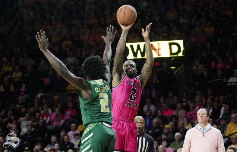 Wichita State sophomore Jamarius Burton shoots a three-pointer during the second half of the game against USF on Feb. 20 inside Charles Koch Arena.