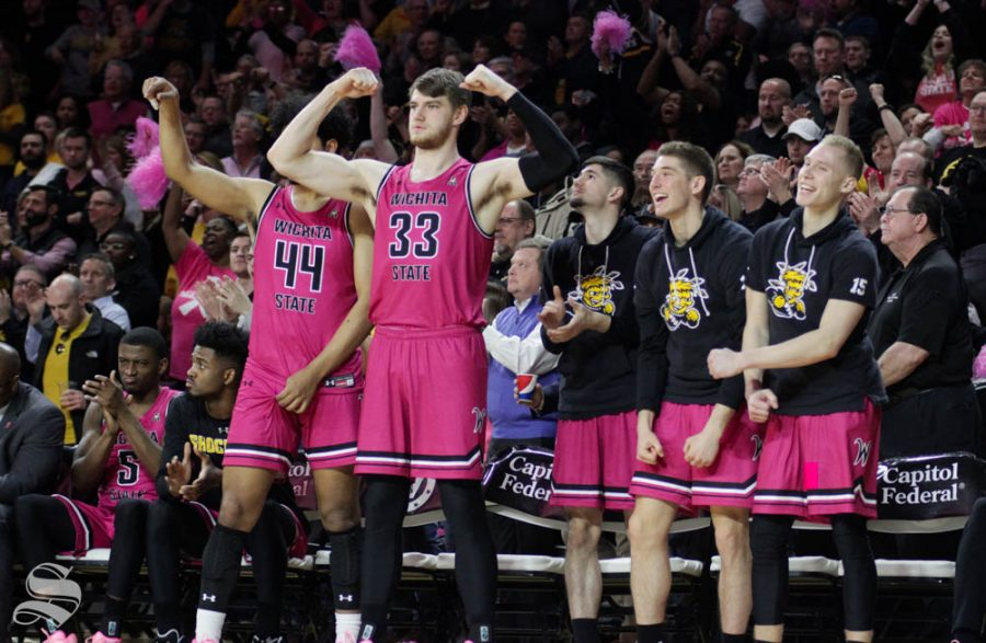 The Wichita State bench celebrates after a dunk during the game against USF on Feb. 20 inside Charles Koch Arena.