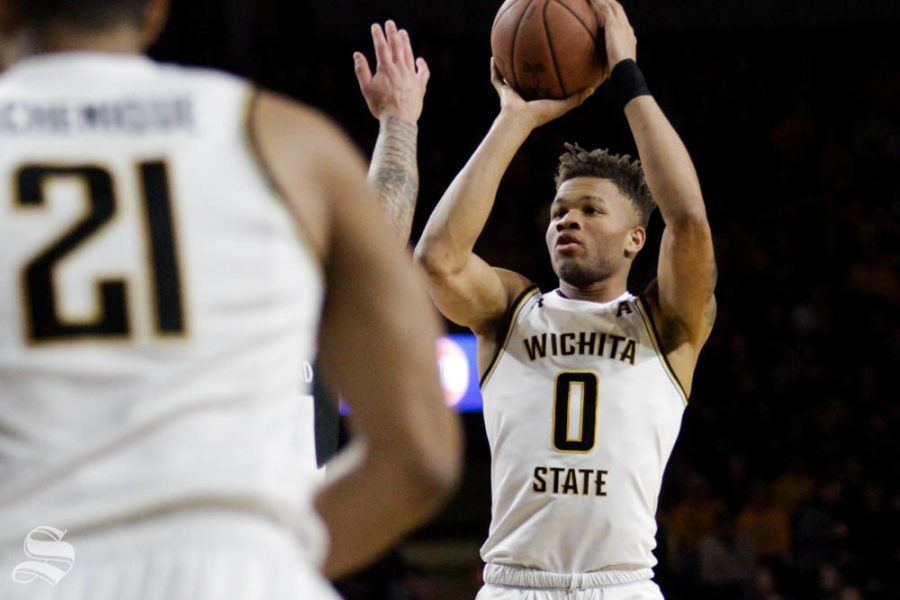 Wichita State sophomore Dexter Dennis shoots a three-pointer during the game against Cincinnati on Feb. 6 inside Charles Koch Arena.