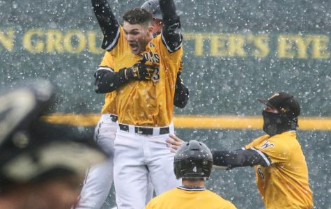 Wichita State's Cade Clemons celebrates after hitting a walk-off against Arkansas-Pine Bluff at Eck Stadium in February.