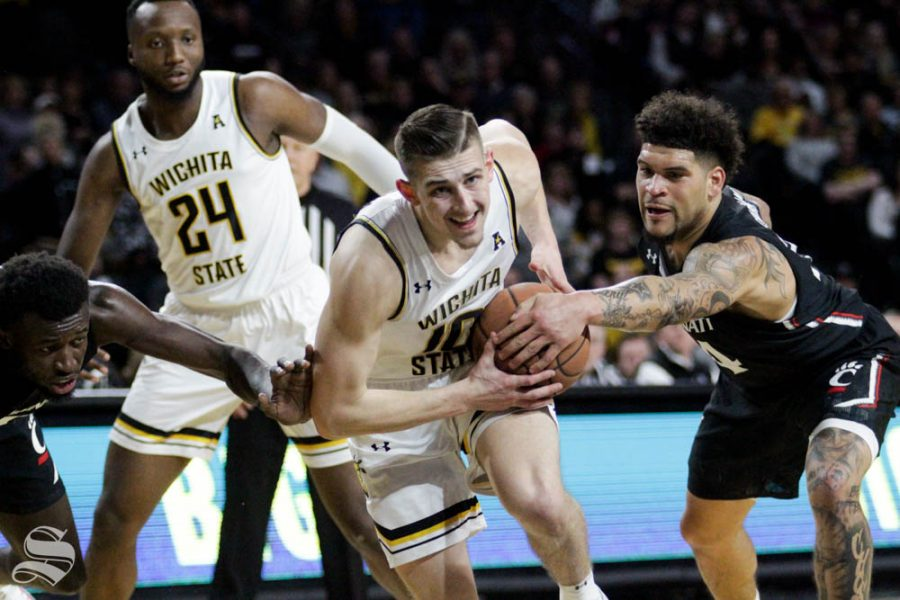 Wichita+State+sophomore+Erik+Stevenson+gets+stripped+by+Cincinnati%27s+Jarron+Cumberland+during+the+first+half+of+the+game+against+Cincinnati+on+Feb.+6+inside+Charles+Koch+Arena.