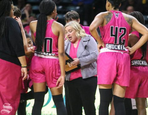 Wichita State head coach Keitha Adams speaks to players during a timeout in the last quarter of the game against East Carolina at Charles Koch Arena on Saturday, Feb. 1, 2020.