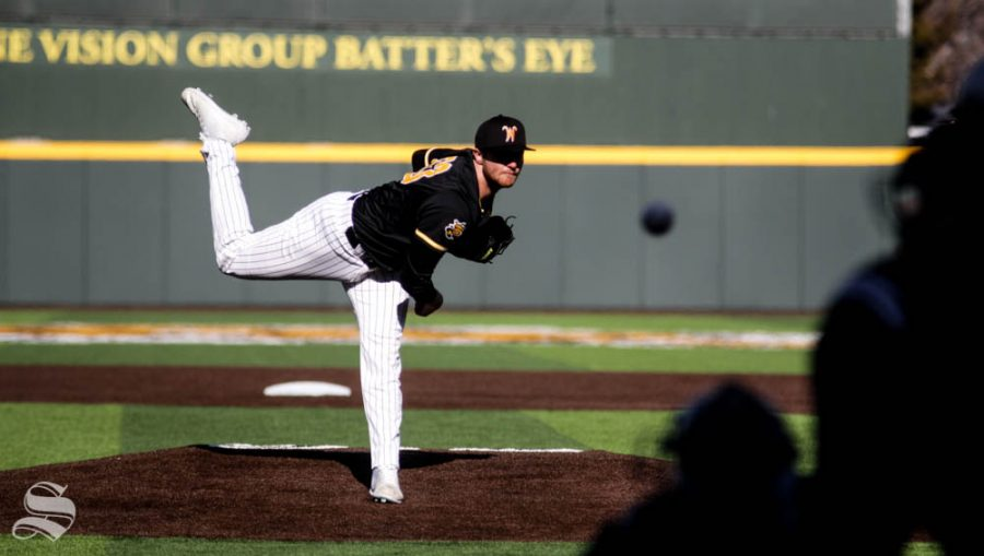 Wichita State junior Tommy Barnhouse pitches the ball during the game against Kansas State on Feb. 26 at Eck Stadium.