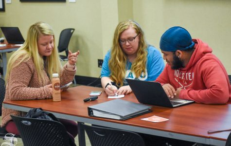 Wichita State students Royce Siebert and Donavon Cheeks speak with SAC president Emily Liston during a meeting that took place earlier in the semester.